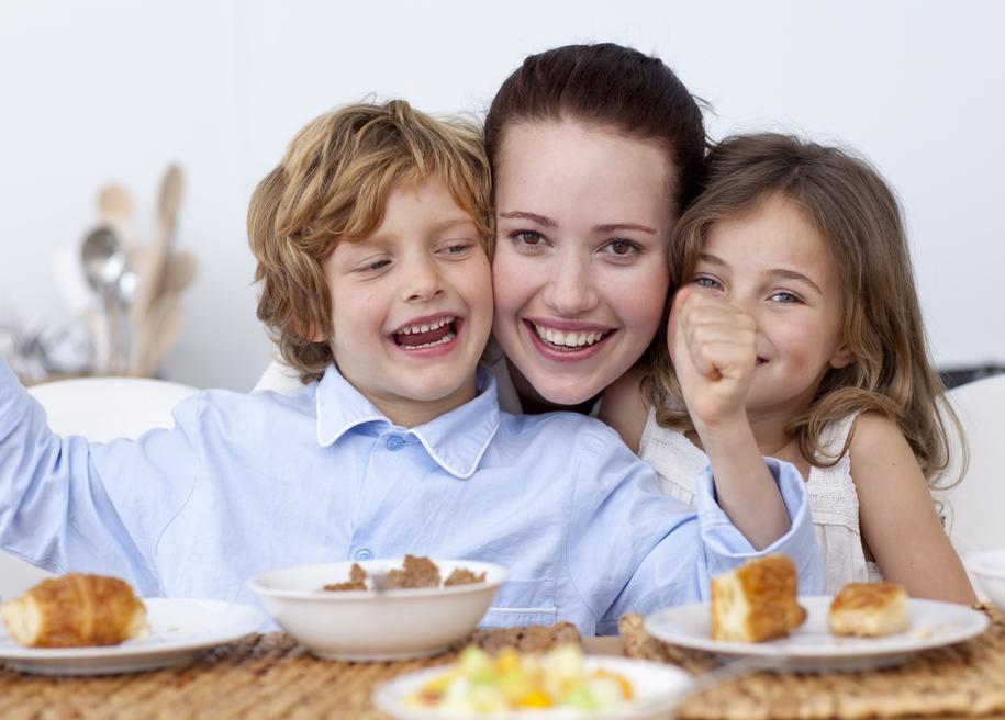 children-and-mother-having-fun-in-breakfast-s
